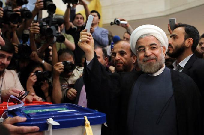 Candidate Hassan Rouhani votes in Iran Election 2013 [via Guardian, source AFP]